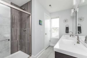 custom bathroom design by HE Homes